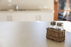 Kitchen tabletop and salt and pepper shakers Royalty Free Stock Image