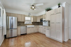 Kitchen with tan cabinetry Stock Photos