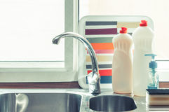 Kitchen tap and detergents close up Stock Photo