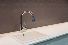 Kitchen tap and sink. Chrome kitchen tap and sink royalty free stock photo