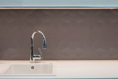 Kitchen tap and sink. Modern chrome kitchen tap and sink stock photos
