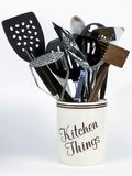 Kitchen Things in Holder. Jar of Kitchen Things holds cooking tools including potatoe masher, spatulas, meat tenderizer, and wooden spoons Stock Photos