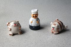 Kitchen timer in the form of a chef figurine and two cats stock photography