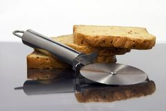 Kitchen tool. A chopper and some slice of bread Royalty Free Stock Photography