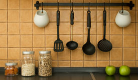 Kitchen tools. Set of kitchen tools on the wall Stock Photo