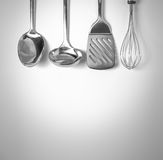 Kitchen tools background. Set of kitchen tools hanged up in the wall Royalty Free Stock Photos