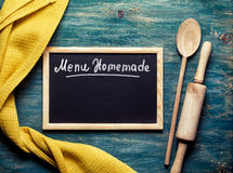 Kitchen tools and Black board on with text. Menu Homemade. Top view Royalty Free Stock Photo