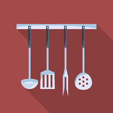 Kitchen tools on a hanger with long shadow. Royalty Free Stock Images