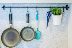 Kitchen tools hanging on the wall Stock Photos
