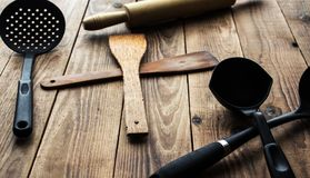 A kitchen tools. On a wooden background Royalty Free Stock Image