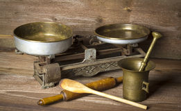 Kitchen tools. Kitchen scales and mortar on wooden background Stock Photos