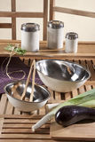Kitchen tools on table in kitchen. Kitchen tools, wood and vegetables Royalty Free Stock Photo