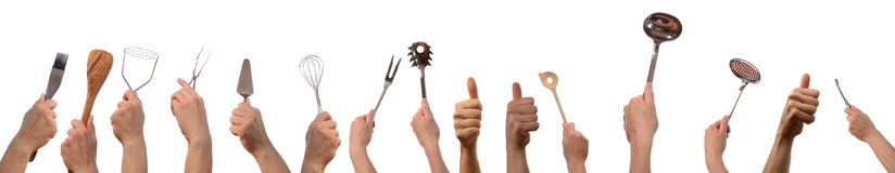 Kitchen tools and thumbs up. Hands with kitchen tools and thumbs up on a white background Royalty Free Stock Images