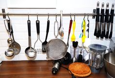 Kitchen tools on a white wall Royalty Free Stock Image