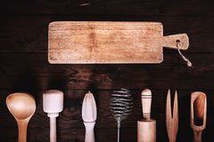 Kitchen tools on a wooden background. Applied toning. Top view. Stock Photography