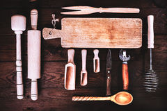 Kitchen tools on a wooden background. Applied toning. Top view. Stock Image