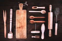 Kitchen tools on a wooden background. Applied toning. Top view. Stock Images