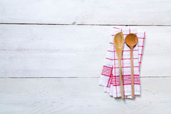 Kitchen towel background with wooden spoons Royalty Free Stock Photo