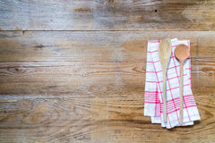 Kitchen towel background with wooden spoons Royalty Free Stock Images