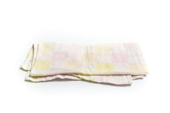 Kitchen towel or table cloth isolated on white background. A kitchen towel or table cloth isolated on white background Stock Photo