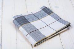 Kitchen towel on white wooden table. Studio Photo Stock Images