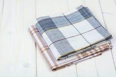 Kitchen towel on white wooden table. Studio Photo Royalty Free Stock Image