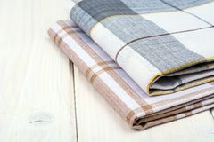 Kitchen towel on white wooden table. Studio Photo Royalty Free Stock Photo