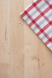 Kitchen towel on wooden background. Kitchen squared towel on wooden background Royalty Free Stock Image