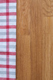 Kitchen towel on wooden background. Kitchen squared red gray and white towel on wooden background Stock Images