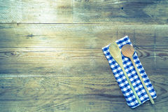 Kitchen towel and wooden spoon background Royalty Free Stock Photo