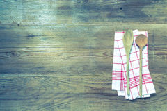 Kitchen towel and wooden spoon background Stock Photo