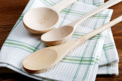 Kitchen towel and wooden spoon Royalty Free Stock Image