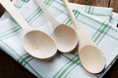 Kitchen towel and wooden spoon Royalty Free Stock Photography