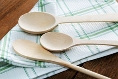 Kitchen towel and wooden spoon Royalty Free Stock Images