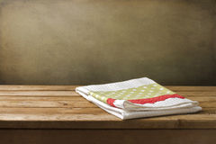 Kitchen towel on wooden table Royalty Free Stock Images