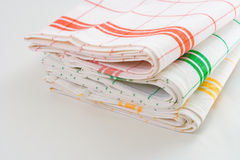 Kitchen Towels. Stack of striped kitchen towels on white background Stock Image