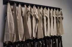 Kitchen Towels. Brown kitchen towels in a row on the wall royalty free stock photography