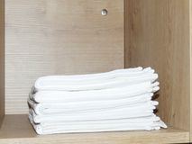 Kitchen towels in the closet. White towels in the  wardrobe, housed in a quiet location. useful accessory in the kitchen, set of 5 white towels Royalty Free Stock Images