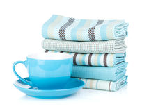 Kitchen towels and coffee cup Royalty Free Stock Photo