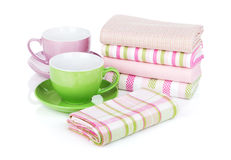 Kitchen towels and coffee cups Stock Photo