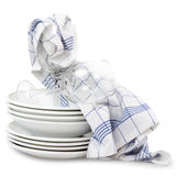 Kitchen towels with dishes Royalty Free Stock Images