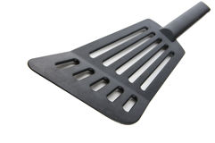Kitchen turner. Black plastic kitchen turner on white Royalty Free Stock Photos