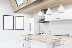 Kitchen with two posters on wall. Royalty Free Stock Photo