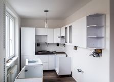 Kitchen under construction. A new white modern kitchen under construction process Royalty Free Stock Images