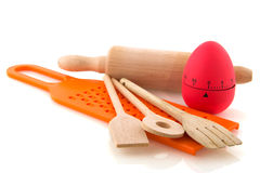 Kitchen utensil. With wooden spoons, cooking egg and grater Stock Images