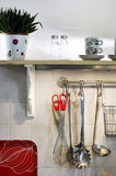 Kitchen Utensil. Cooking utensils hanging on the wall in a kitchen Stock Image