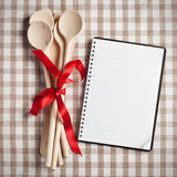 Kitchen utensil with blank recipe book Royalty Free Stock Photos