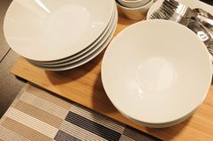 Set of Porcelain Plates, Bowls and Silverware Stock Photo