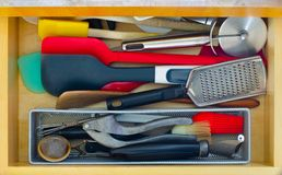 Kitchen utensil drawer disordered stock photos