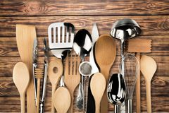 Kitchen utensil. Cooking utensil wooden spoon kitchen knife spatula equipment frame Royalty Free Stock Photography
